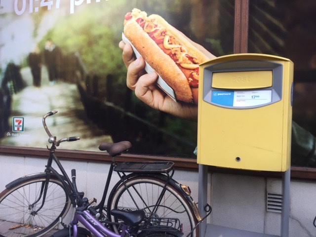 Hot Dog poster and bicycle