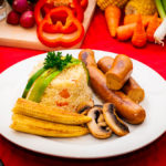 nie table with plate of pilaf rice and sausages