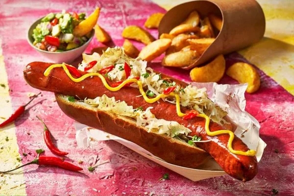chilli beef giant frankfurter in a bun with sides