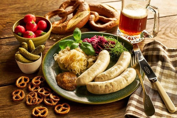 A Plate of German White Sausage With Pretzels, Sauerkraut and a Stein of Beer