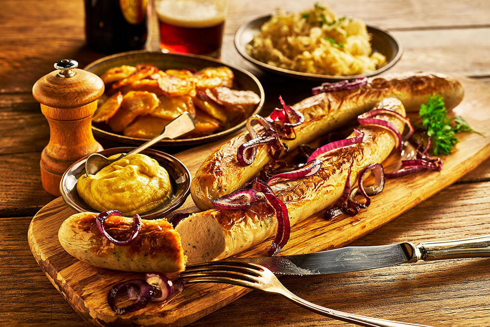 Bratwurst sausage on wooden board