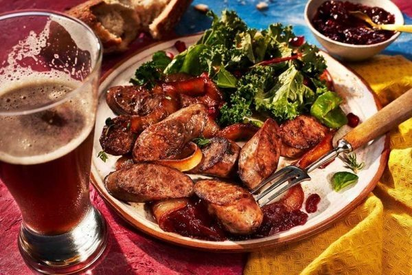 Venison Wild Boar and Pork Bratwurst With beer and salad