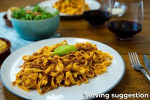 Beef Bolognese Served with Pasta, Salad and Red Wine