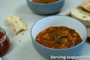 A Bowl of Beef Goulash Soup with Crusty Bread