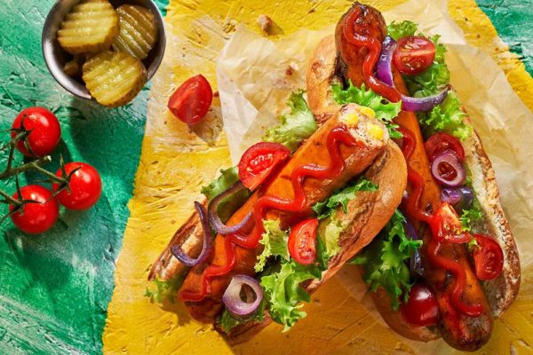 Cheese Frankfurters in Buns with Salad and Garnishes