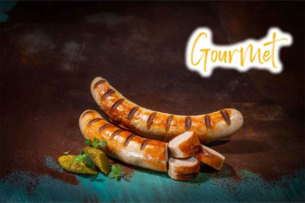 Two Cooked and Sliced Iberico Pork Gourmet Bratwurst Sausages with Gherkins