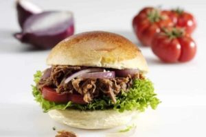BBQ Pulled Beef, Lettuce, Onion and Tomato in a Bun