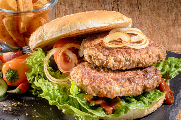 beef burger in bun with onion